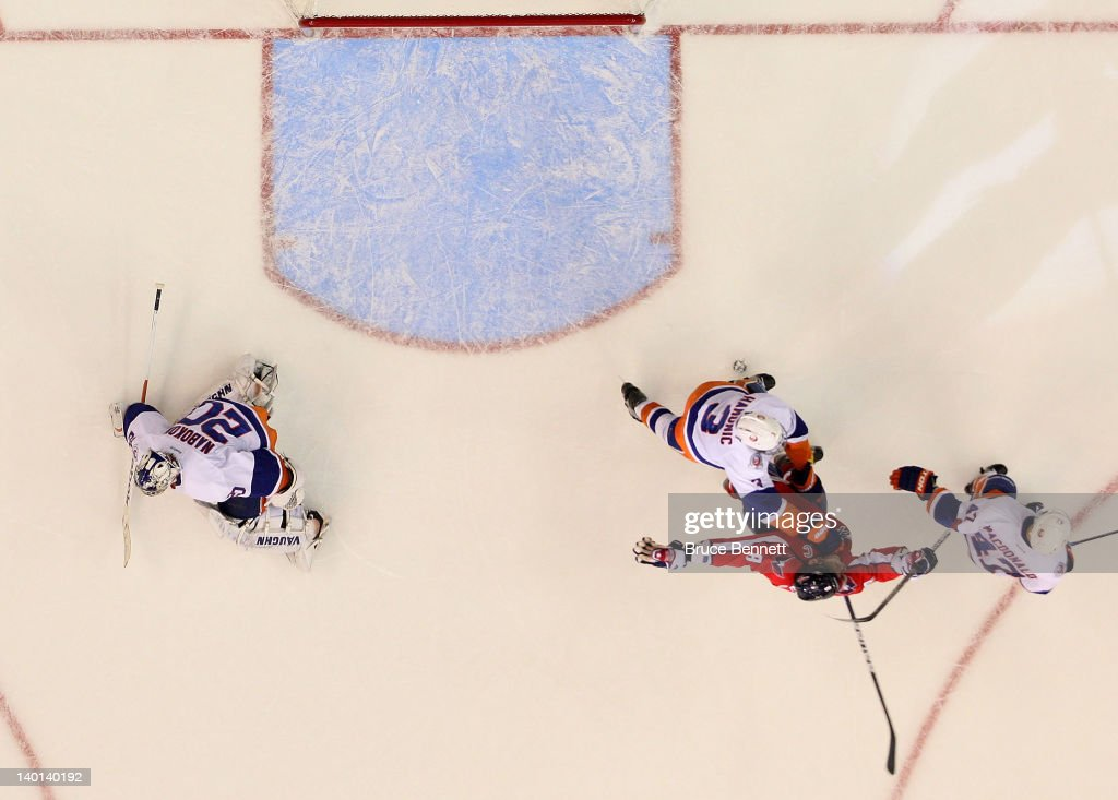 Alex Ovechkin #8 of the Washington Capitals celebrates the game winning goal against <a gi-track='captionPersonalityLinkClicked' href=/galleries/search?phrase=Evgeni+Nabokov&family=editorial&specificpeople=171380 ng-click='$event.stopPropagation()'>Evgeni Nabokov</a> #20 of the New York Islanders at the Verizon Center on February 28, 2012 in Washington, DC. The Capitals defeated the Islanders 3-2 in overtime.