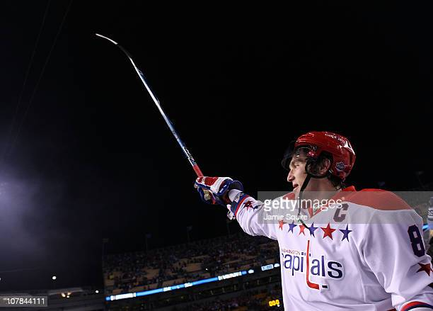 Alex Ovechkin of the Washington Capitals celebrates their 31 victory over the Pittsburgh Penguins during the 2011 NHL Bridgestone Winter Classic at...