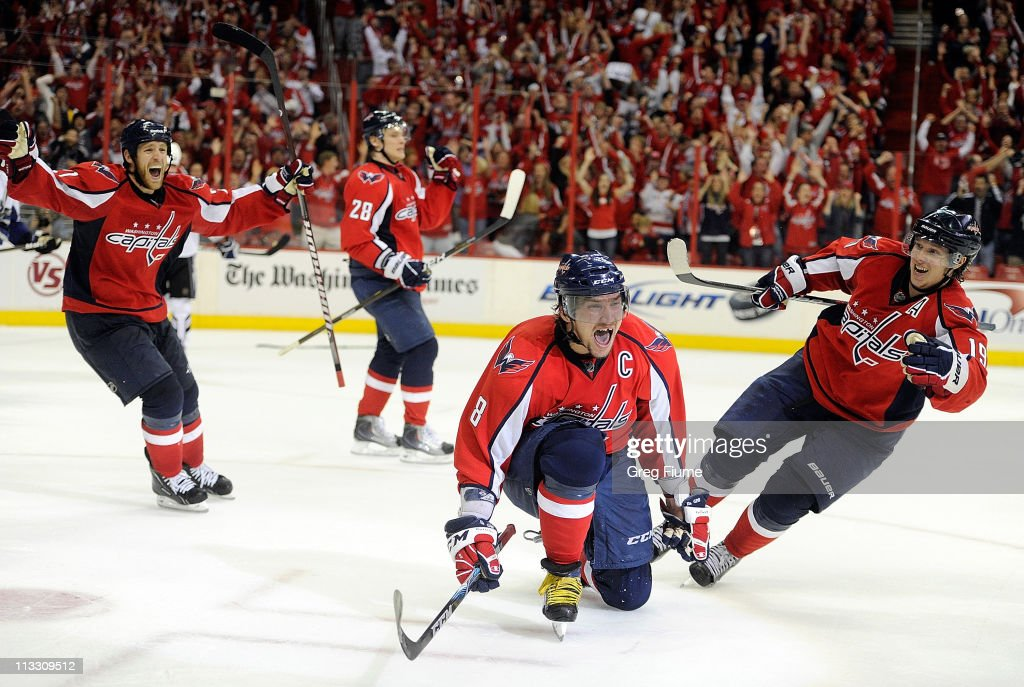 Alex Ovechkin #8 of the Washington Capitals celebrates with <a gi-track='captionPersonalityLinkClicked' href=/galleries/search?phrase=Brooks+Laich&family=editorial&specificpeople=554432 ng-click='$event.stopPropagation()'>Brooks Laich</a> #21, <a gi-track='captionPersonalityLinkClicked' href=/galleries/search?phrase=Alexander+Semin&family=editorial&specificpeople=206654 ng-click='$event.stopPropagation()'>Alexander Semin</a> #28, and Nicklas Backstrom #19 after scoring the tying goal in the third period against the Tampa Bay Lightning during Game Two of the Eastern Conference Semifinal during the 2011 NHL Stanley Cup Playoffs at the Verizon Center on May 1, 2011 in Washington, DC.