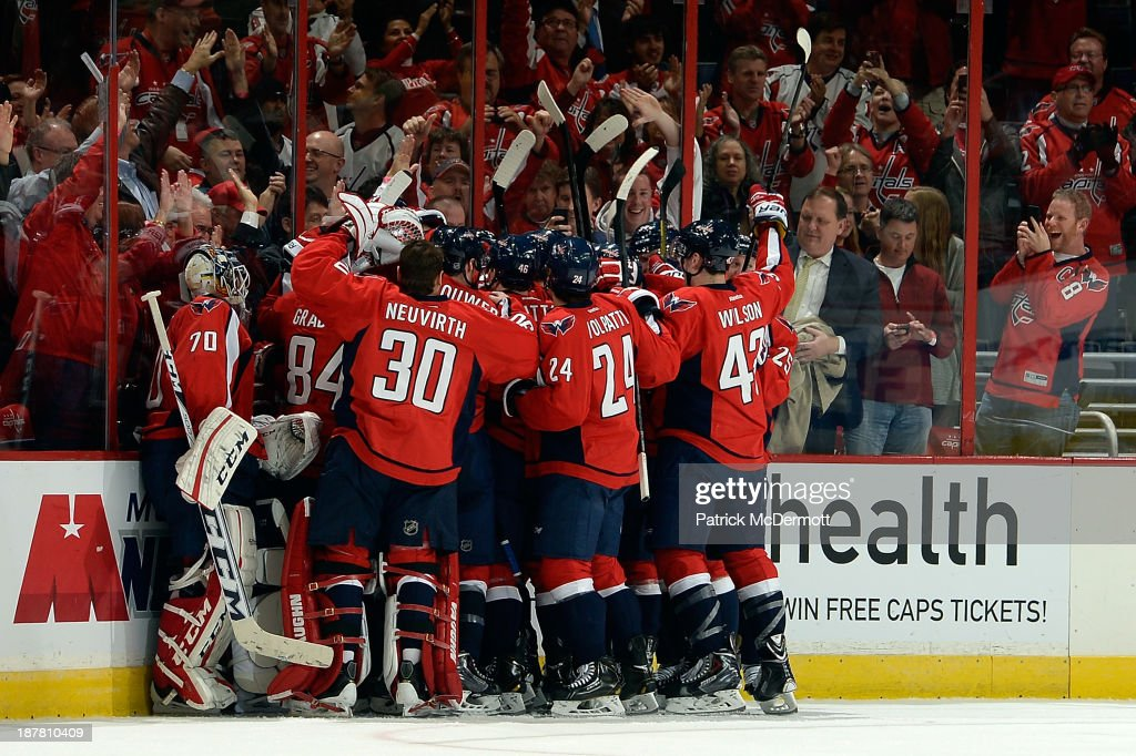 Alex Ovechkin #8 of the Washington Capitals celebrates with his teammates after scoring the game winning goal in overtime during an NHL game against the Columbus Blue Jackets at Verizon Center on November 12, 2013 in Washington, DC. The Capitals defeated the Blue Jackets 4-3.