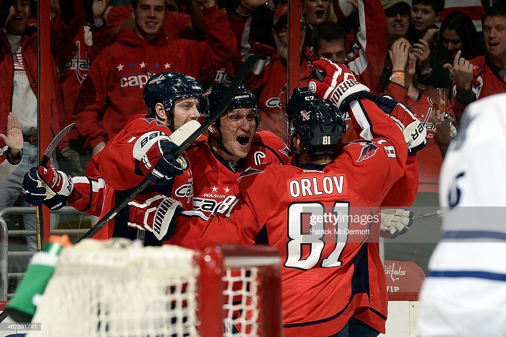 Alex Ovechkin #8 of the Washington Capitals celebrates with his teammates after scoring a goal in the second period during an NHL game against the Toronto Maple Leafs at Verizon Center on January 10, 2014 in Washington, DC.