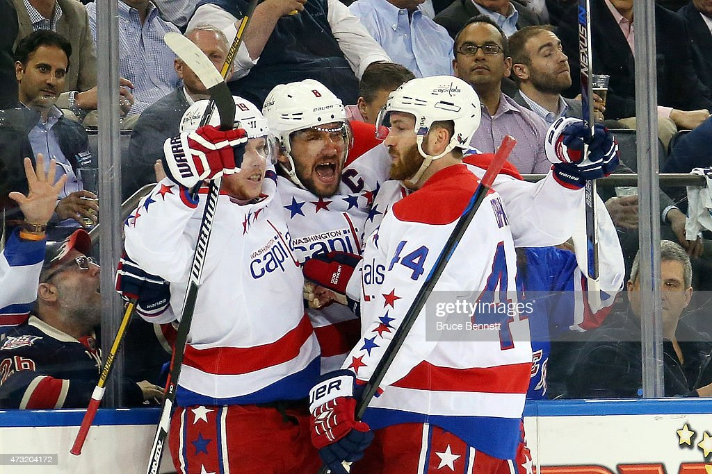 Alex Ovechkin of the Washington Capitals celebrates with his teammates after scoring a goal in the first peroid against the New York Rangers in Game...