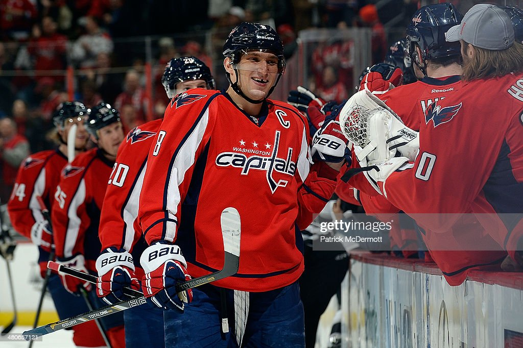 Alex Ovechkin #8 of the Washington Capitals celebrates with his teammates after scoring a goal in the first period during an NHL game against the Los Angeles Kings at Verizon Center on March 25, 2014 in Washington, DC.