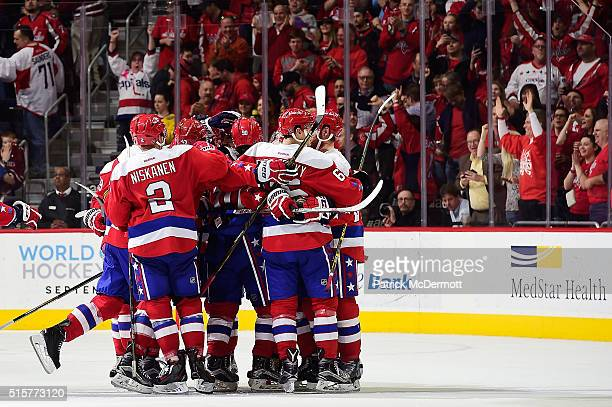 Alex Ovechkin of the Washington Capitals celebrates with his teammates after scoring the game winning goal in overtime during a game against the...