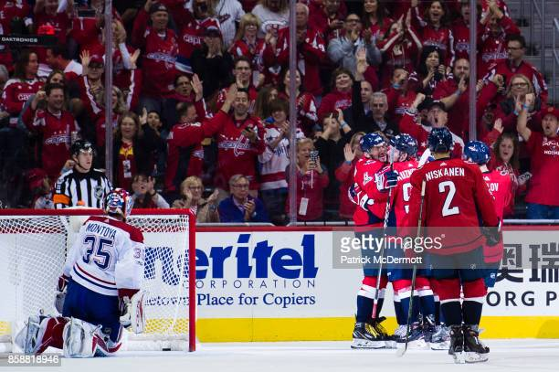 Alex Ovechkin of the Washington Capitals celebrates with his teammates after scoring his fourth goal of the game against the Montreal Canadiens in...