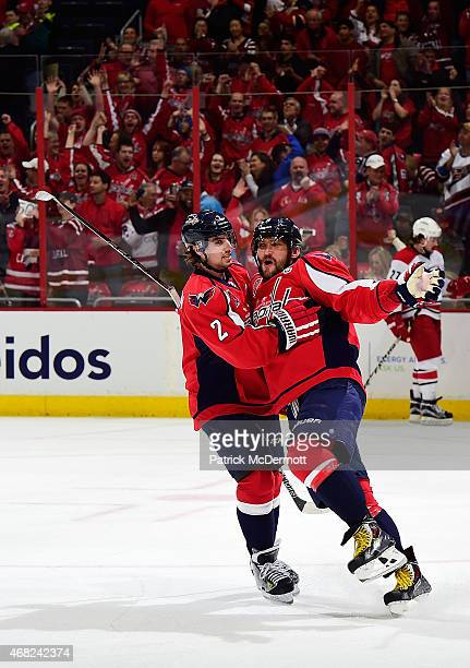 Alex Ovechkin of the Washington Capitals celebrates with his teammate Matt Niskanen after scoring a goal in the first period during an NHL game...