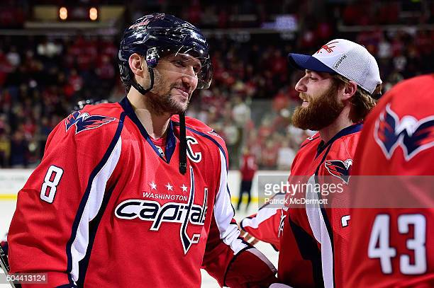 Alex Ovechkin of the Washington Capitals celebrates with his teammate Braden Holtby after the Capitals defeated the Ottawa Senators 71 during an NHL...