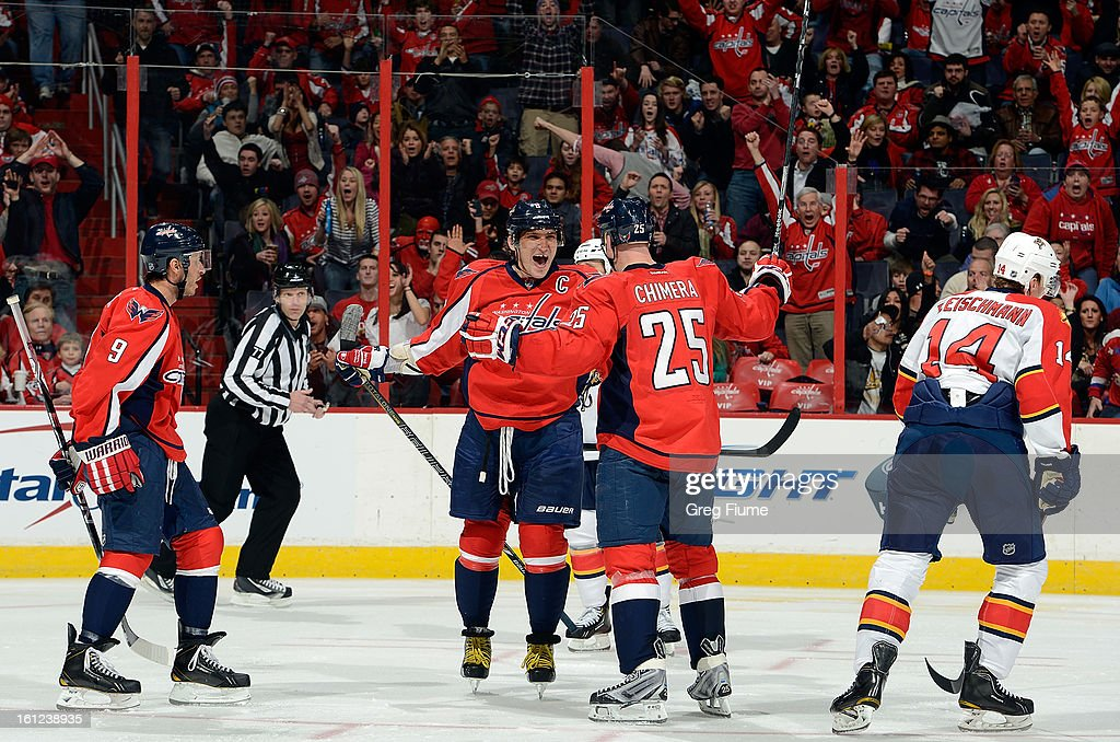 Alex Ovechkin #8 of the Washington Capitals celebrates with <a gi-track='captionPersonalityLinkClicked' href=/galleries/search?phrase=Jason+Chimera&family=editorial&specificpeople=211264 ng-click='$event.stopPropagation()'>Jason Chimera</a> #25 and <a gi-track='captionPersonalityLinkClicked' href=/galleries/search?phrase=Mike+Ribeiro&family=editorial&specificpeople=203275 ng-click='$event.stopPropagation()'>Mike Ribeiro</a> #9 after scoring in the third period against the Florida Panthers at the Verizon Center on February 9, 2013 in Washington, DC.