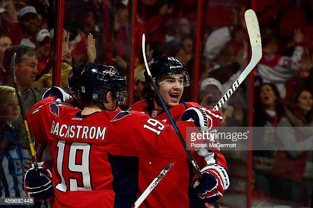 Alex Ovechkin of the Washington Capitals celebrates with Nicklas Backstrom and Tom Wilson after scoring a goal in the second period against the New...