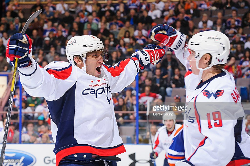 Alex Ovechkin #8 of the Washington Capitals celebrates with Nicklas Backstrom #19 after Nicklas scored the team's third goal against the Edmonton Oilers during an NHL game at Rexall Place on October 24, 2013 in Edmonton, Alberta, Canada. The Capitals defeated the Oilers 4-1.