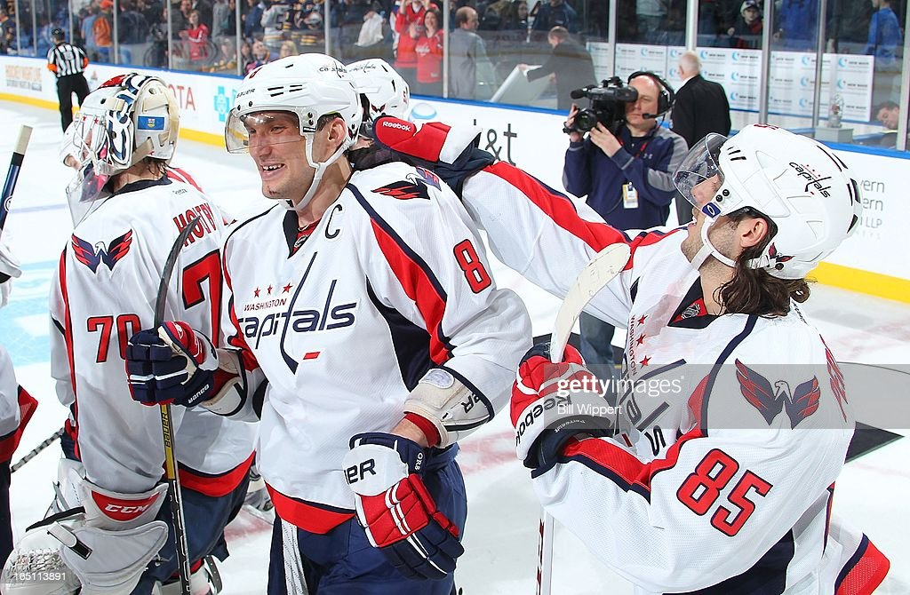 Alex Ovechkin #8 of the Washington Capitals celebrates with teammate <a gi-track='captionPersonalityLinkClicked' href=/galleries/search?phrase=Mathieu+Perreault&family=editorial&specificpeople=776813 ng-click='$event.stopPropagation()'>Mathieu Perreault</a> #85 after scoring the game winning shootout goal against the Buffalo Sabres on March 30, 2013 at the First Niagara Center in Buffalo, New York. Washington defeated Buffalo, 4-3.