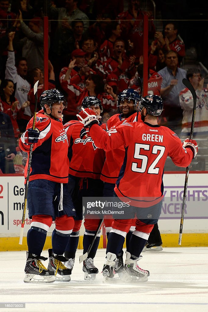 Alex Ovechkin #8 of the Washington Capitals celebrates with teammates after scoring in the third period of an NHL game against the Columbus Blue Jackets at Verizon Center on October 19, 2013 in Washington, DC.