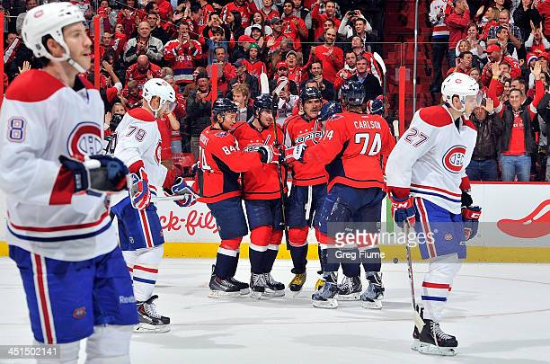 Alex Ovechkin of the Washington Capitals celebrates with teammates after scoring a goal in the third period against the Montreal Canadiens at the...
