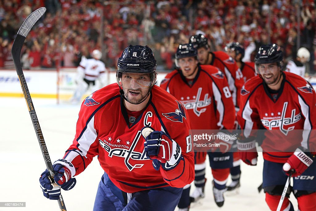 Alex Ovechkin #8 of the Washington Capitals celebrates with teammates after scoring a third period goal against the New Jersey Devils at Verizon Center on October 10, 2015 in Washington, DC. The Washington Capitals won, 5-3.