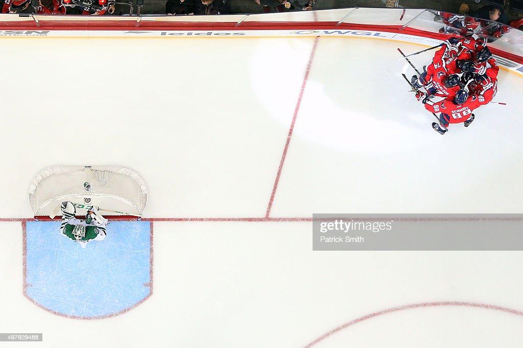 Alex Ovechkin of the Washington Capitals celebrates with teammates after scoring a third period goal on goalie Kari Lehtonen of the Dallas Stars at...