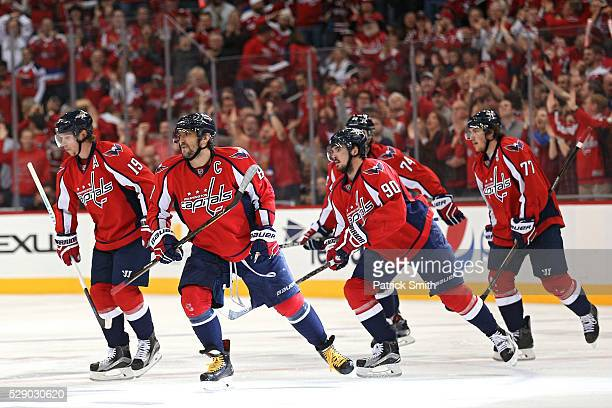 Alex Ovechkin of the Washington Capitals celebrates with teammates after scoring against the Pittsburgh Penguins during the first period in Game Five...