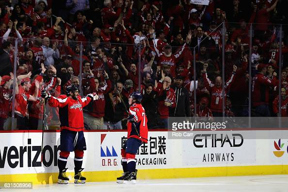 Alex Ovechkin of the Washington Capitals celebrates with TJ Oshie after scoring a goal for his 1000th career point against the Pittsburgh Penguins in...