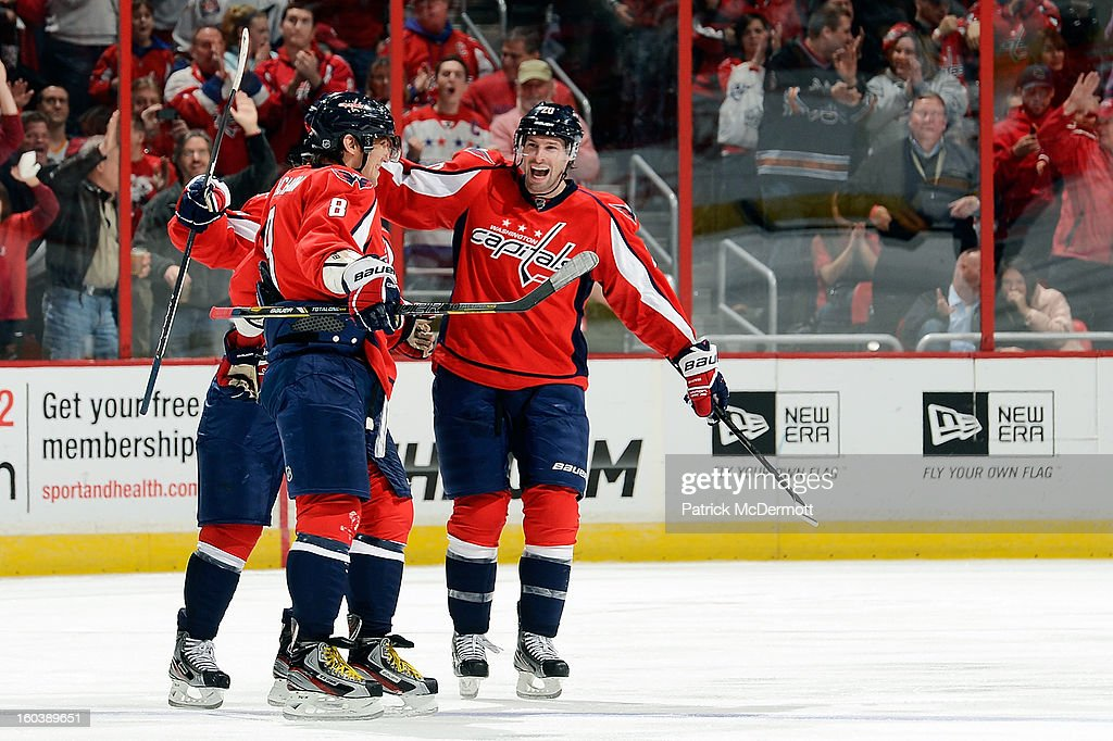 Alex Ovechkin #8 of the Washington Capitals celebrates with <a gi-track='captionPersonalityLinkClicked' href=/galleries/search?phrase=Troy+Brouwer&family=editorial&specificpeople=4155305 ng-click='$event.stopPropagation()'>Troy Brouwer</a> #20 of the Washington Capitals after Ovechkin's first goal of the season in the third period of an NHL hockey game betweeen Buffalo Sabres and Washington Capitals at Verizon Center on January 27, 2013 in Washington, DC.