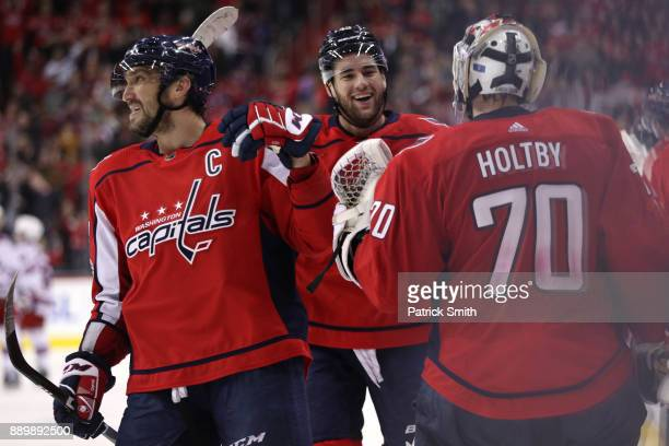 Alex Ovechkin of the Washington Capitals celebreates teammate Tom Wilson of the Washington Capitals goal against the New York Rangers during the...