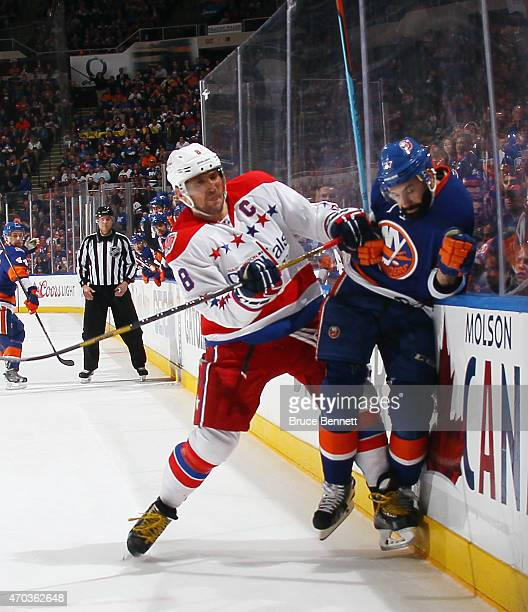 Alex Ovechkin of the Washington Capitals checks Brian Strait of the New York Islanders during the second period in Game Three of the Eastern...