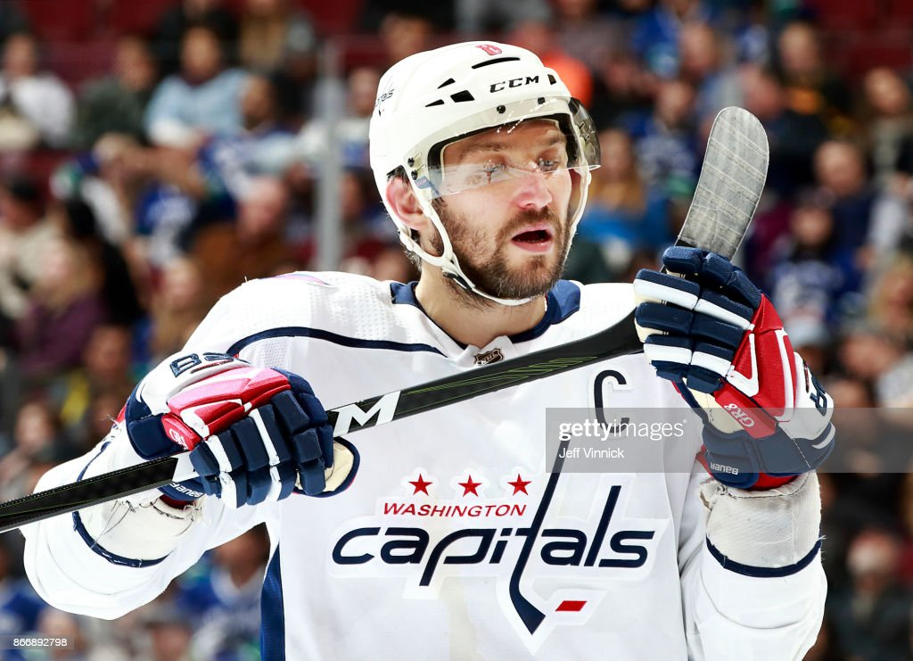 Alex Ovechkin #8 of the Washington Capitals checks his stick during their NHL game against the Vancouver Canucks at Rogers Arena October 26, 2017 in Vancouver, British Columbia, Canada. Vancouver won 6-2.