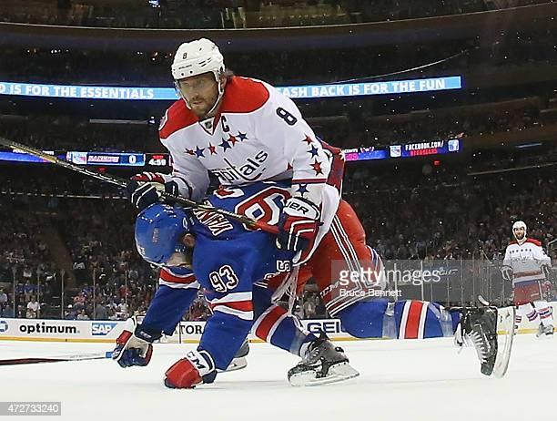 Alex Ovechkin of the Washington Capitals checks Keith Yandle of the New York Rangers in Game Five of the Eastern Conference Semifinals during the...
