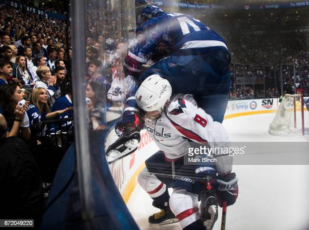 Alex Ovechkin of the Washington Capitals checks Nazem Kadri of the Toronto Maple Leafs during the second period in Game Six of the Eastern Conference...