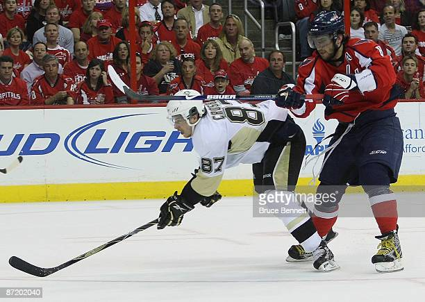 Alex Ovechkin of the Washington Capitals checks Sidney Crosby of the Pittsburgh Penguins during Game Seven of the Eastern Conference Semifinal Round...