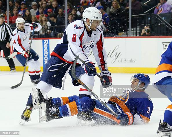 Alex Ovechkin of the Washington Capitals checks Travis Hamonic of the New York Islanders during the third period at the Barclays Center on January 7...