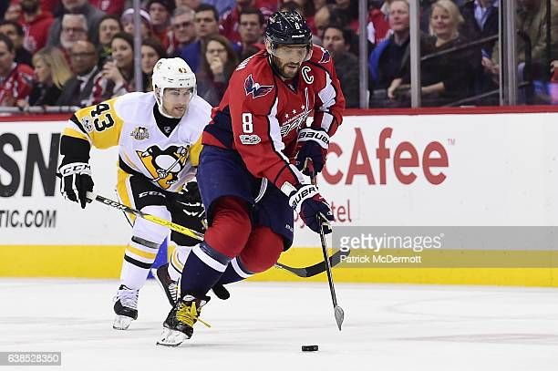 Alex Ovechkin of the Washington Capitals controls the puck against Conor Sheary of the Pittsburgh Penguins in the first period during an NHL game at...
