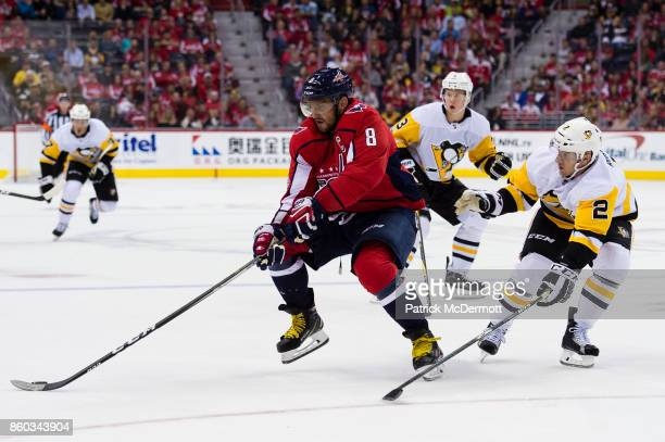 Alex Ovechkin of the Washington Capitals controls the puck against Chad Ruhwedel of the Pittsburgh Penguins in the third period at Capital One Arena...