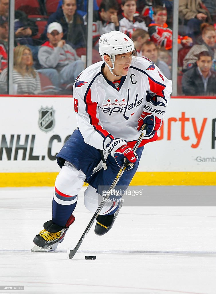 Alex Ovechkin #8 of the Washington Capitals controls the puck during game action against the New Jersey Devils at the Prudential Center on April 4, 2014 in Newark, New Jersey.