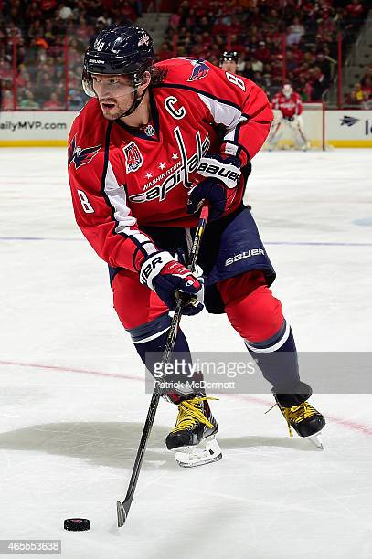 Alex Ovechkin of the Washington Capitals controls the puck in the second period during an NHL game against the Buffalo Sabres at Verizon Center on...