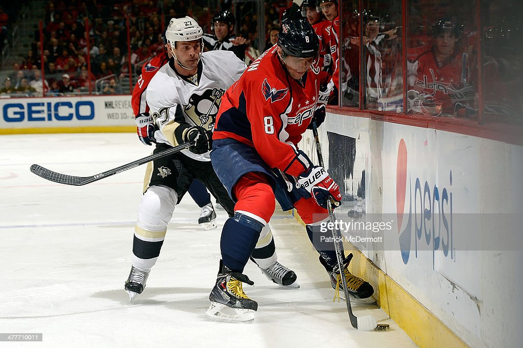 Alex Ovechkin #8 of the Washington Capitals controls the puck in the second period against <a gi-track='captionPersonalityLinkClicked' href=/galleries/search?phrase=Craig+Adams&family=editorial&specificpeople=211144 ng-click='$event.stopPropagation()'>Craig Adams</a> #27 of the Pittsburgh Penguins during an NHL game at Verizon Center on March 10, 2014 in Washington, DC.