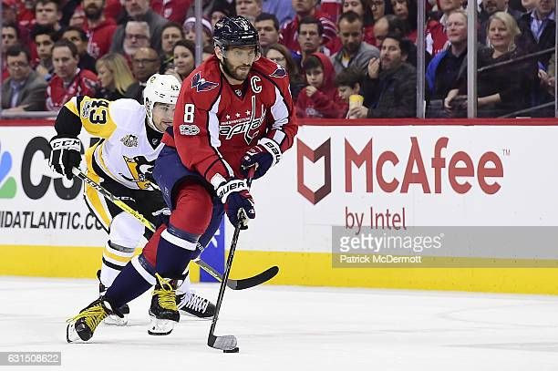 Alex Ovechkin of the Washington Capitals controls with the puck against Conor Sheary of the Pittsburgh Penguins in the first period during an NHL...