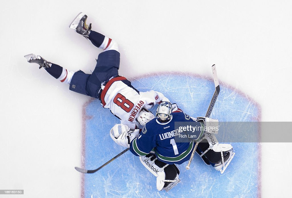 Alex Ovechkin #8 of the Washington Capitals crashes in to goalie <a gi-track='captionPersonalityLinkClicked' href=/galleries/search?phrase=Roberto+Luongo&family=editorial&specificpeople=202638 ng-click='$event.stopPropagation()'>Roberto Luongo</a> #1 of the Vancouver Canucks after getting tripped up during the first period in NHL action on October 28, 2013 at Rogers Arena in Vancouver, British Columbia, Canada.