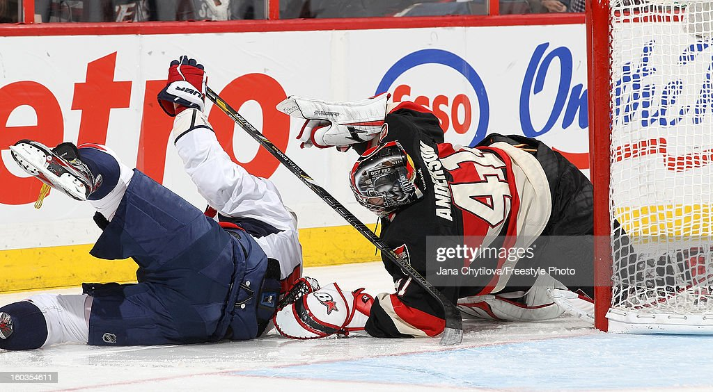 Alex Ovechkin #8 of the Washington Capitals crashes into the net and <a gi-track='captionPersonalityLinkClicked' href=/galleries/search?phrase=Craig+Anderson&family=editorial&specificpeople=211238 ng-click='$event.stopPropagation()'>Craig Anderson</a> #41 of the Ottawa Senators during an NHL game at Scotiabank Place on January 29, 2013 in Ottawa, Ontario, Canada.