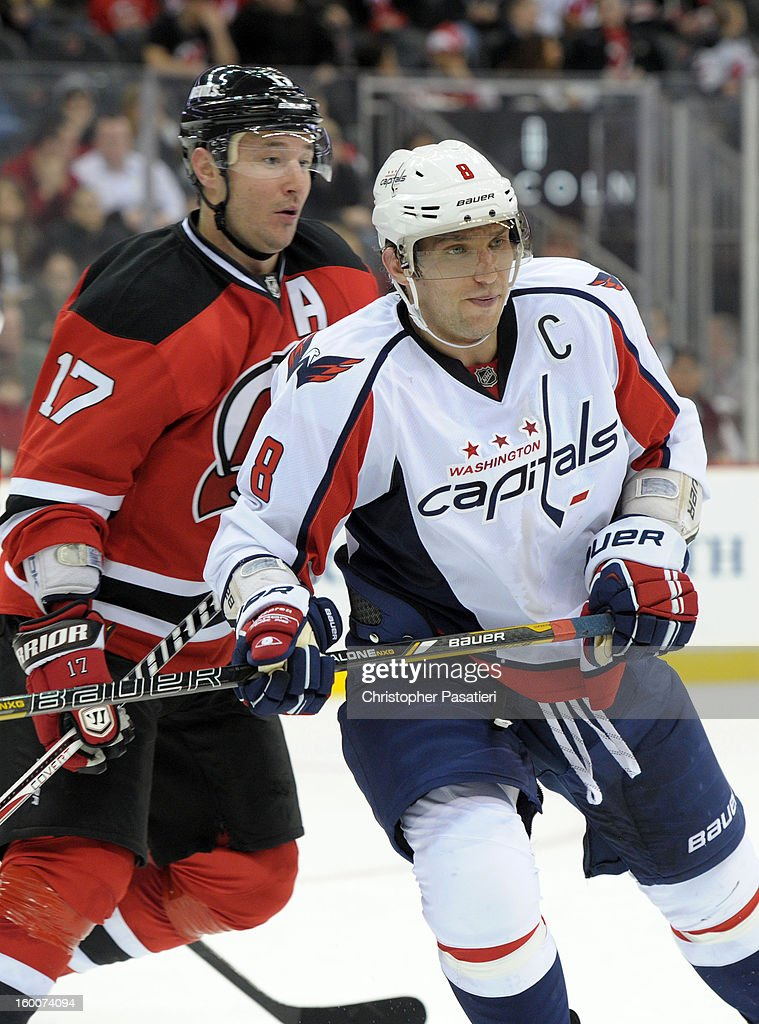 Alex Ovechkin #8 of the Washington Capitals faces off against <a gi-track='captionPersonalityLinkClicked' href=/galleries/search?phrase=Ilya+Kovalchuk&family=editorial&specificpeople=201796 ng-click='$event.stopPropagation()'>Ilya Kovalchuk</a> #17 of the New Jersey Devils during the game on January 25, 2013 at the Prudential Center in Newark, New Jersey.