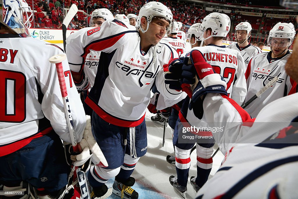 Alex Ovechkin #8 of the Washington Capitals fist bumps teammates after defeating the Carolina Hurricanes 5-2 during their NHL game at PNC Arena on April 10, 2014 in Raleigh, North Carolina.