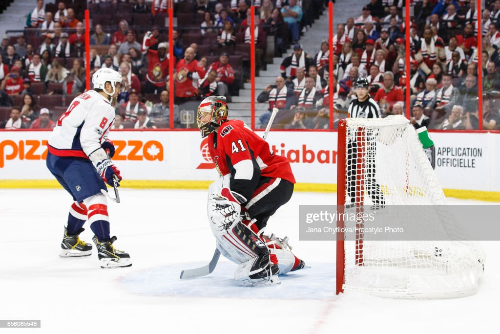 Alex Ovechkin #8 of the Washington Capitals gets the puck past Craig Anderson #41 of the Ottawa Senators during a shoot-out at Canadian Tire Centre on October 5, 2017 in Ottawa, Ontario, Canada.