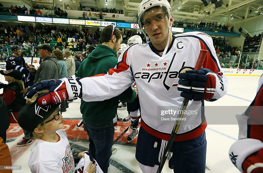 Alex Ovechkin #8 of the Washington Capitals gives a signed jersey to a fan after facing the Winnipeg Jets during Kraft Hockeyville Day 2 at Yardmen Arena on September 14, 2013 in Belleville, Ontario, Canada.