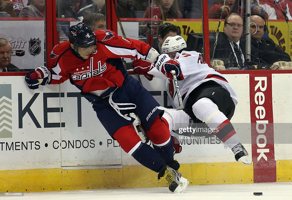 Alex Ovechkin #8 of the Washington Capitals hits <a gi-track='captionPersonalityLinkClicked' href=/galleries/search?phrase=Alexei+Ponikarovsky&family=editorial&specificpeople=210628 ng-click='$event.stopPropagation()'>Alexei Ponikarovsky</a> #12 of the New Jersey Devils at the Verizon Center on February 23, 2013 in Washington, DC. The Capitals defeated the Devils 5-1.