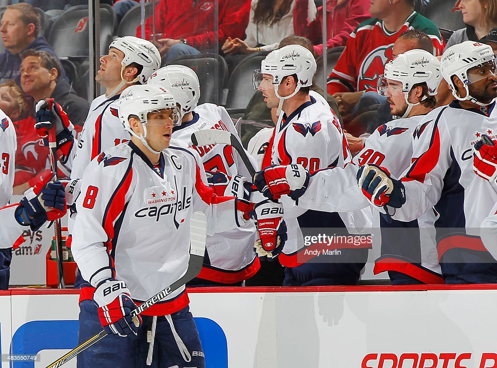 Alex Ovechkin #8 of the Washington Capitals is congratulated by teammates after scoring a first-period goal against the New Jersey Devils during the game at the Prudential Center on April 4, 2014 in Newark, New Jersey.