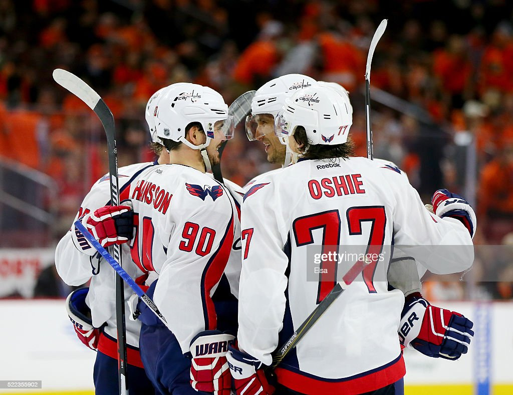 Alex Ovechkin #8 of the Washington Capitals is congratulated by teammates Marcus Johansson #90 and T.J. Oshie #77 after he scored in the third period against the Philadelphia Flyers in Game Three of the Eastern Conference Quarterfinals during the 2016 NHL Stanley Cup Playoffs at Wells Fargo Center on April 18, 2016 in Philadelphia, Pennsylvania.The Washington Capitals defeated the Philadelphia Flyers 6-1.