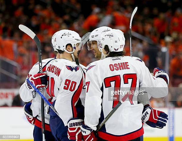 Alex Ovechkin of the Washington Capitals is congratulated by teammates Marcus Johansson and TJ Oshie after he scored in the third period against the...