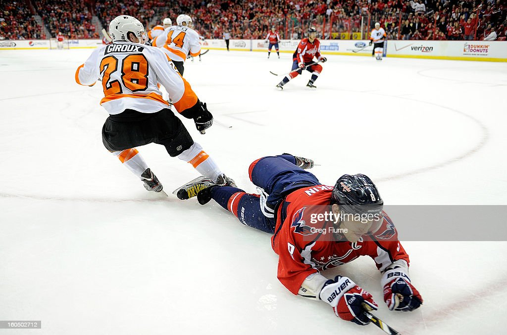 Alex Ovechkin #8 of the Washington Capitals is tripped up by <a gi-track='captionPersonalityLinkClicked' href=/galleries/search?phrase=Claude+Giroux&family=editorial&specificpeople=537961 ng-click='$event.stopPropagation()'>Claude Giroux</a> #28 of the Philadelphia Flyers at the Verizon Center on February 1, 2013 in Washington, DC.