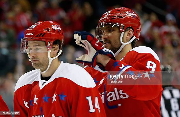 Alex Ovechkin of the Washington Capitals jokes around with teammate Justin Williams following the Wizards 52 win over the New York Rangers at Verizon...