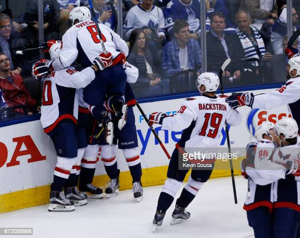 Alex Ovechkin of the Washington Capitals jumps into the arms of teammate Marcus Johansson after he scored the game and series winning goal on the...