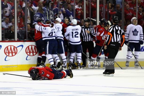Alex Ovechkin of the Washington Capitals lays on the ice after being injured in the first period against the Toronto Maple Leafs in Game Five of the...