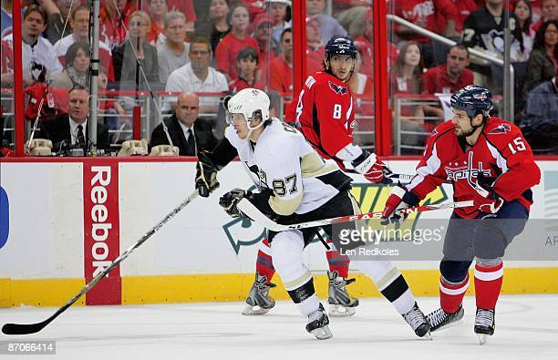 Alex Ovechkin of the Washington Capitals looks back at Sidney Crosby of the Pittsburgh Penguins during Game Five of the Eastern Conference Semifinal...